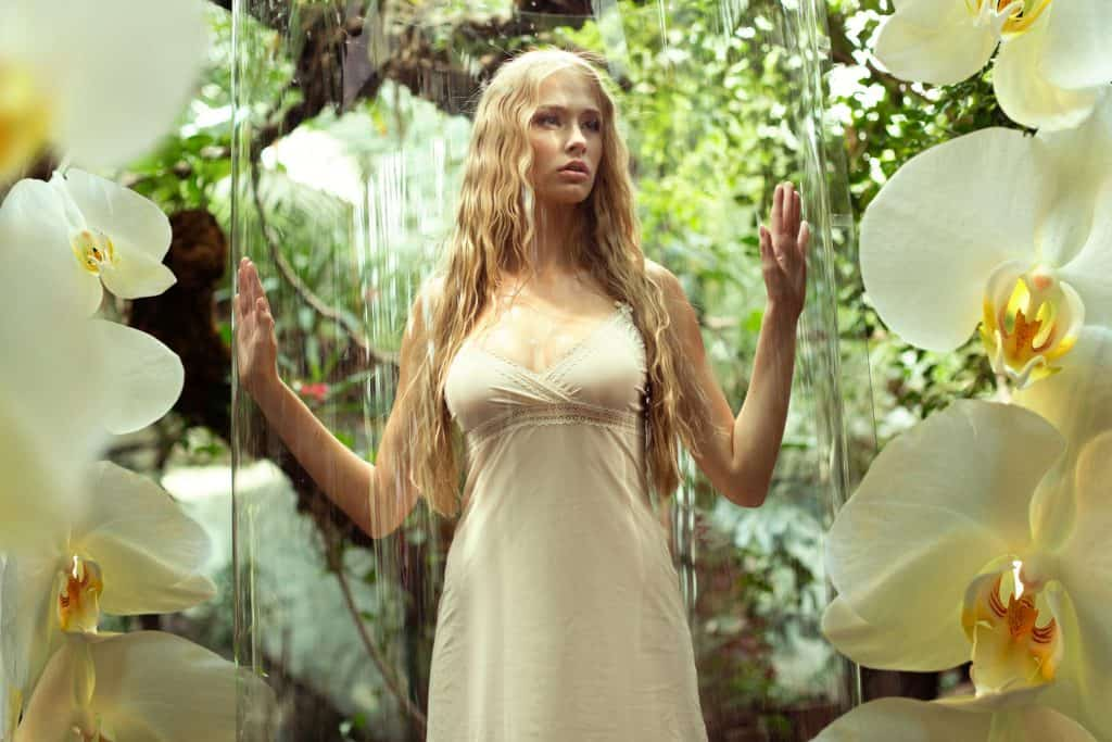 Glass cage for cute woman